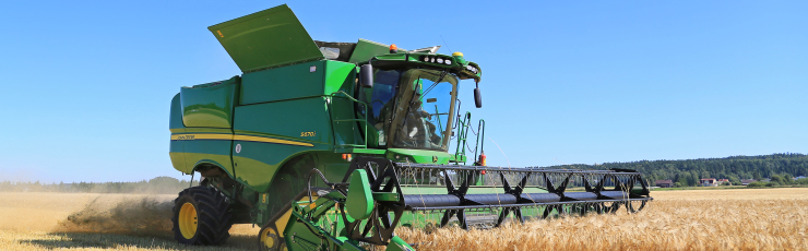 SALO, FINLAND - AUGUST 22, 2015: John Deere Combine s670i harvests barley at Puontin Peltopaivat Agricultural Harvesting and Cultivating Show.